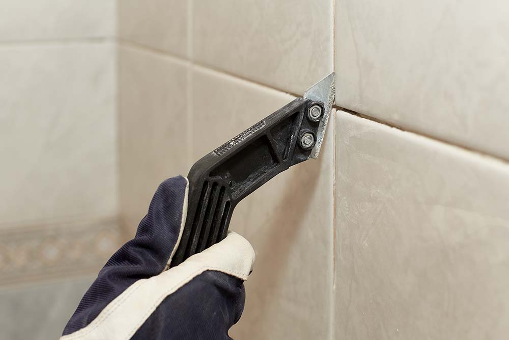 removing damaged grout